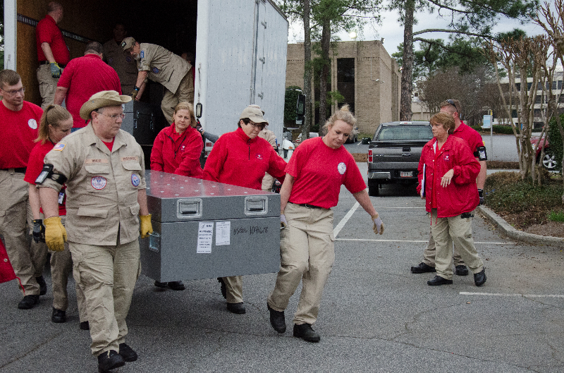 Disaster medical responders unloading equipment during a training exercise.